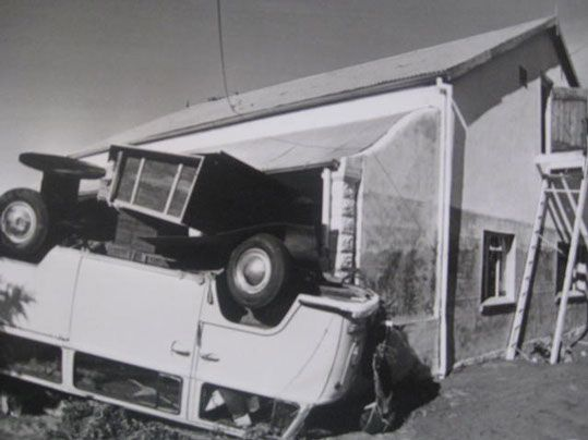 Overturned combi against the now Golf View Guest House.