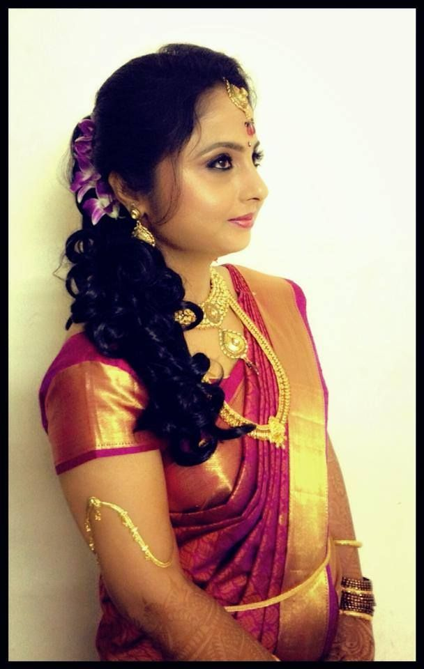 Indian Bride 39 S Reception Hairstyle Updo Indian Bridal Hairstyles