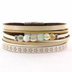 Bracelet manchette beige avec perles