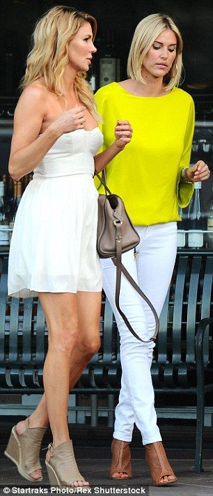 Kristen Taekman is comforted by Brandi Glanville over a glass of wine #dailymail