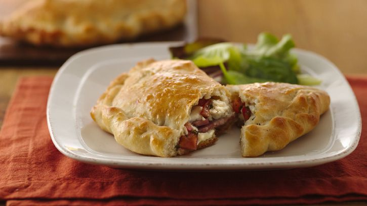Try homemade calzones for a laid-back dinner that's easily prepared ahead of time or frozen for later on in the week.