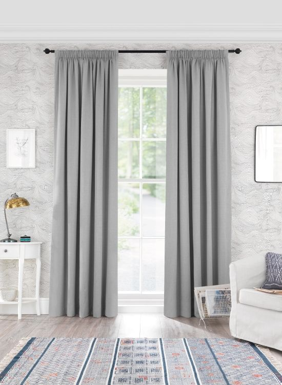 Windsor is a textured, heavyweightcotton fabric in a 'duck egg' green-grey shade. The weight and quality of this fabric makes it hang as well as a bespoke pair of curtains. Made right here in the UK, all our ready made curtains are available in unique extra long and extra wide sizes and with a thermal blackout lining option.
