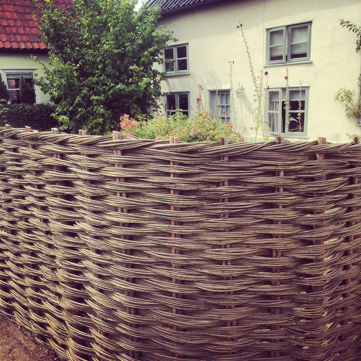 Woven willow fence at the front of our cottage