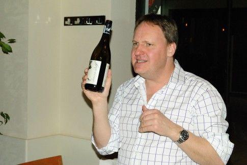 Richard Fox holding a bottle.