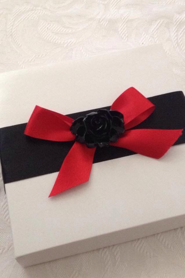 A personal favourite from my Etsy shop https://www.etsy.com/listing/222799606/3d-boxed-invitation-black-red-rose