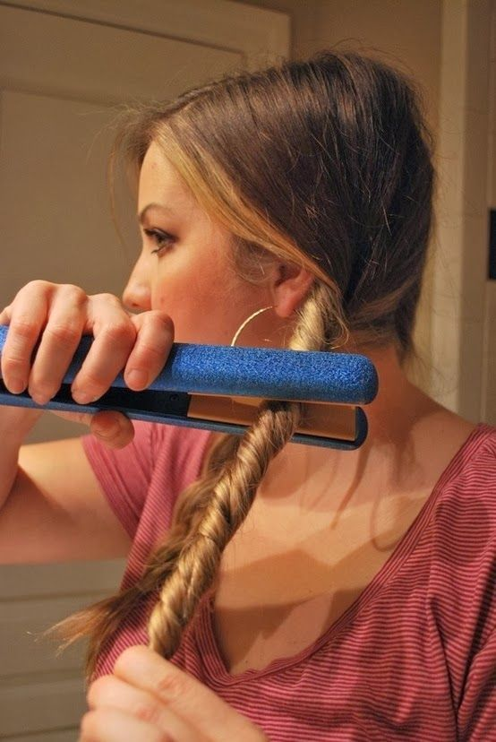 Create Easy Beachy Waves with just your flat iron!  1. Split and braid your hair into two sections. Spritz each braid lightly with heat protectant such as Kenra. 2. Twist each braid away from your face then twist the flat iron onto your hair in the same direction your hair is twisted. (Do not touch rubberband  you will get a wierd crease.) 3.  After hair is cooled, take them out and run your fingers through. 4. Spritz with a light hairspray, such as Big Sexy Hair's Spray and Play, and…
