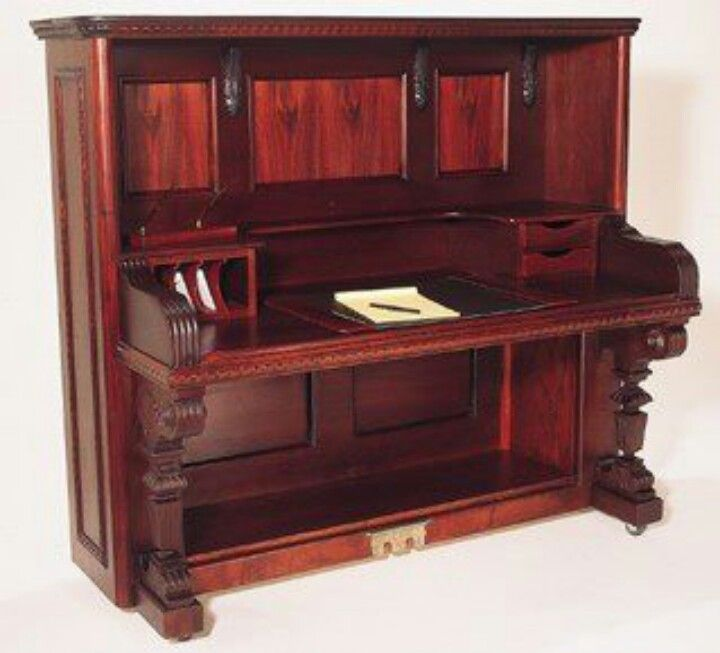 Desk made from an old piano.  If it's not playable anymore, I like that it can still be upcycled.