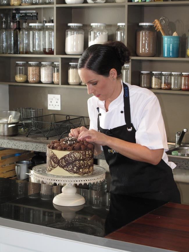 Katrien at work on the choclate lace collar for her Milktart cake -www.katrienscakes.co.za and Facebook