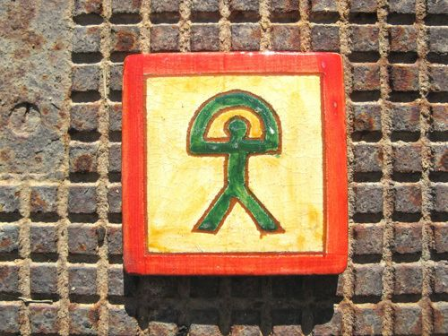 Spanish ceramic tile / coaster ~ Indalo. This dazzling little handmade Spanish tile / coaster is a blaze of rich, vibrant colours. Each one is individually hand-painted in the Almeriense Alpujarras, in the sierras above the coast close to Granada, and features the lucky Indalo symbol of the area. It has a lovely rustic quality.