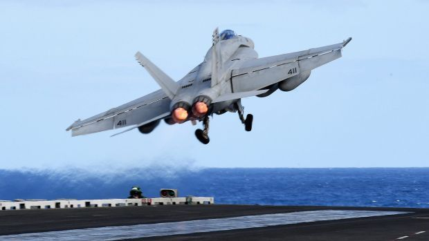 An F/A-18F Super Hornet takes off from the USS Ronald Reagan when it was in the Coral Sea earlier this week, about 650km ...