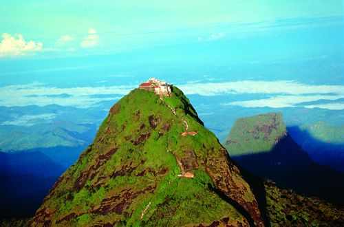 Adam's Peak (Sri Lanka). 'Climbing Adam's Peak was my most magical experience in Sri Lanka. Among lights glowing in the darkness and the smell of ginger, I relished pilgrims' chants and encouraging cheerful smiles. Reaching the freezing top of the sacred mountain was a most fulfilling sensation.' http://www.lonelyplanet.com/sri-lanka/the-hill-country/adams-peak-sri-pada