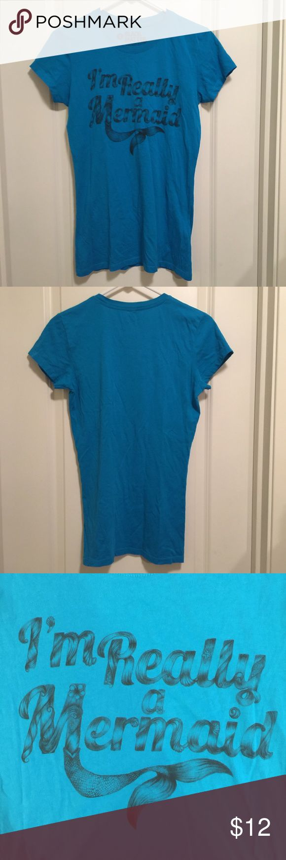I'm Really A Mermaid Tee Perfect For Halloween I'm Really a Mermaid, blue t-shirt. Black Matter brand, juniors size large. Good used condition, only hand washed and never put in dryer. Super cute shirt for Halloween or anyone that loves mermaids. Super pretty color on. Smoke/pet free home. Open to offers! Bundle and save! Black Milk tagged for exposure. Blackmilk Tops Tees - Short Sleeve