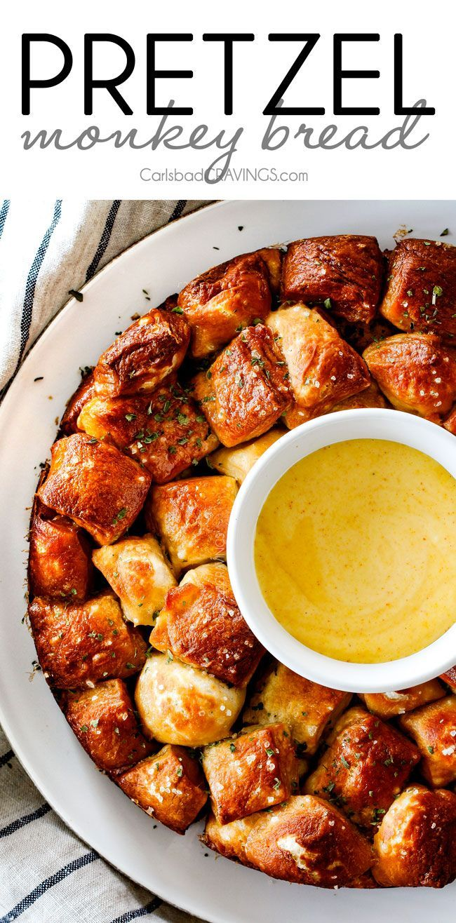 Soft, buttery Pretzel Monkey Bread with the most addicting Honey Mustard Dip! I always bring this crowd pleasing appetizer to parties and it is the first to go!