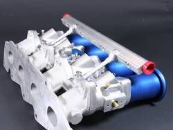 PRO-RACE Zetec 4 cyl Kit 50/48/45 Suits Ford Zetec Engines:  - Supplied with Performance Manifold - Tapered bore size 50/48/45 (50mm at ram tube flange/48mm butterfly/45mm port before blending to port shape)  Kit Includes:- 2 x Pro-Race Tapered Bore throttle bodies, 1 x Pro-Race fuel rail kit, 1 x Pro-Series joiner balancer with cable pull & throttle stop linkage, 1 x Throttle cable bracket 4 x Pro-Series ram tubes. (TPS, Regulator, regulator mounting kit and injectors not included P.O.A)