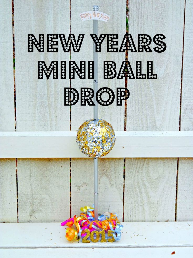 To make -- Mini Ball Drop -- need wood base, dowel, smooth foam ball and sequins or mirror ball ornament, silver paint, metallic star garland stuff, curling ribbon and one Happy New Year Foil Tiara