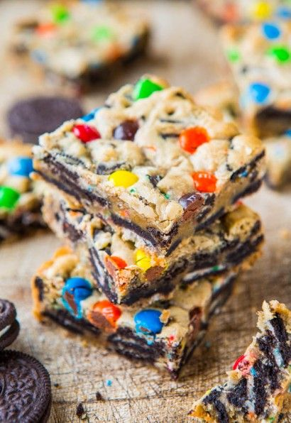 Loaded M&M Oreo Cookie Bars  1/2 cup unsalted butter (1 stick), melted  1 large egg  1 cup light brown sugar, packed  1 tablespoon vanilla extract  1 cup all-purpose flour  18 Oreo Cookies, coarsely chopped or about 2 heaping cups of coarsely chopped add-ins including leftover cookies, graham crackers, chocolate-covered pretzels, etc. about 1/2 cup M&M's. Bake 350 for 20-22 minutes.