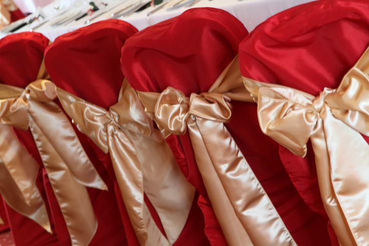 Red Chair Covers with Gold Satin Bows
