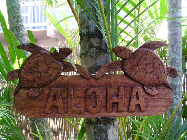 Here is a hand made wooden welcome sign ALOHA, featuring 2 hand carved Hawaiian turtles . This great piece of handycraft measures 12 inches long by 7.5 inches tall. Very Tropical and Polynesian. Perfect for your home decoration or your outdoor living area!