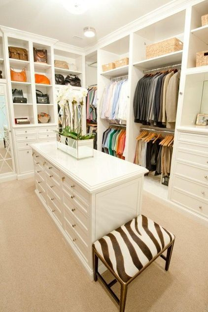 Made for two in Houston. Set up with an island for easy organization and instant traffic routes, this closet has plenty of smart storage ideas.