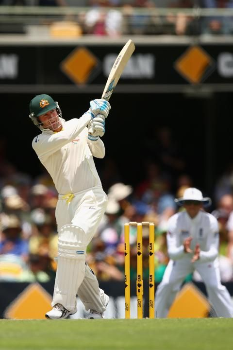 Australia's David Warner (R) celebrates his century next to England's Joe Root during the third day's play of the first Ashes cricket test match in Brisbane November 23, 2013. Australian captain Michael Clarke bats during day three of the First Ashes Test match between Australia and England at The Gabba on November 23, 2013 in Brisbane, Australia.