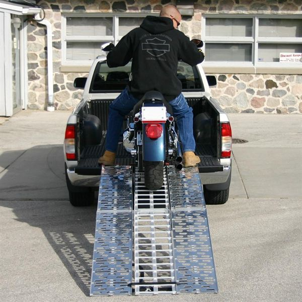 Bike ramps being used to load a motorcycle.