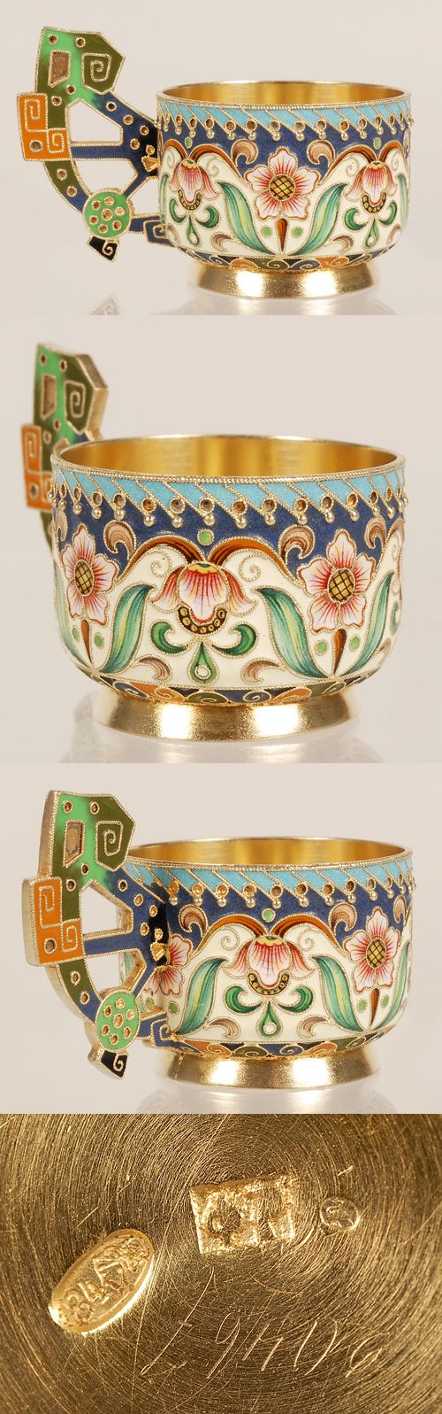 A Russian silver gilt and shaded cloisonne enamel caska, Feodor Ruckert, Moscow, 1896-1908. The cylindrical body on a raised flaring base decorated in a stylized multi-color scrolling floliate motif against a cream enamel ground, the pierced pan-Slavic handle similarly worked