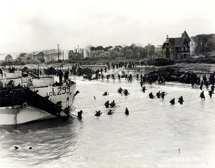 This picture was taken on D-Day and it shows Canadians landing at Juno beach. This source is credible because it was in a photo gallery on the Canada at War website. This picture represents Canadians lives changing at the time it was taken because they won against the Nazis and liberated western Europe.