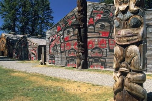Picture of a totem pole and native decorated huts in the Ksan Indian Village in British Columbia
