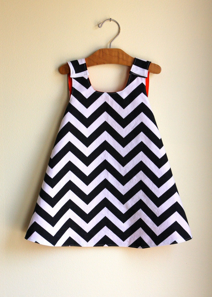 Black and white chevron pinafore dress. - reversible any color. Love the pattern #babydress