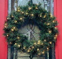 """24 Inch Olympia Spruce Pre-lit Christmas Wreath by Savannah Outdoor Classics. $38.99. Heavy Gage Branches. 210 Tips. Flame-Resistant and Non-Allergenic. 75 Clear Lights. Indoor/Outdoor Use. Deluxe 24"""" Valley Pine Christmas Pre-Lit Wreath  You don't get much more classic than this when it comes to Christmas wreaths. The 24 in. Valley Pine Pre-lit Wreath - Clear Lights features a whopping 210 tips pointing in the same direction with 75 brilliant clear lights. UL ap..."""