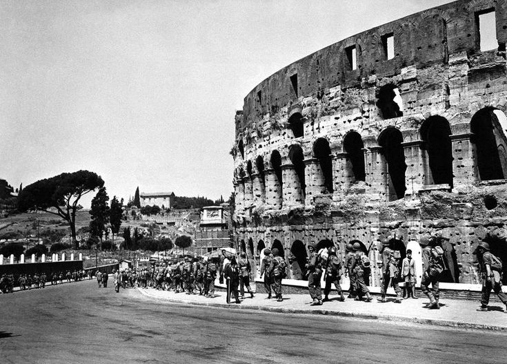 U.S. soldiers march past the historical Roman Colosseum and follow their retreating enemy in Rome, Italy, on June 5, 1944. #