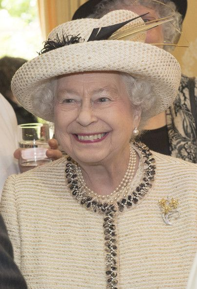 HM Queen Elizabeth II wearing a brooch with three daffodils representing Wales (possible gift from the Sultan of Oman, part of a set of 4 brooches representing the 4 parts of the United Kingdom).