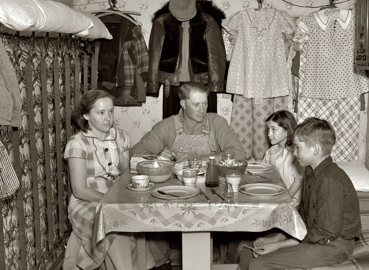 """December 1936. """"Marcus Miller and family in shack that he built himself. Spencer, Iowa. This is half the house."""