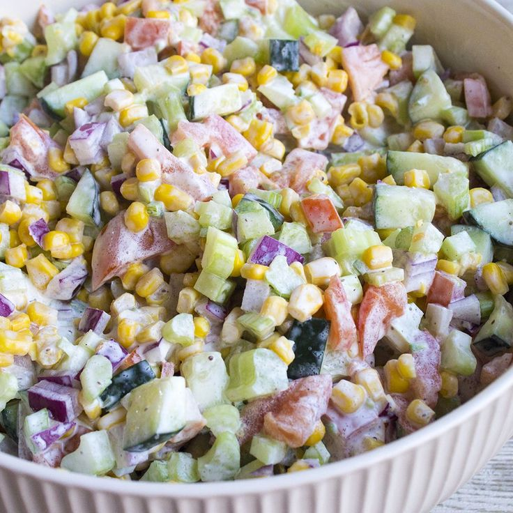 This Fresh Vegetable Salad is a quick and delicious side dish perfect for potlucks!