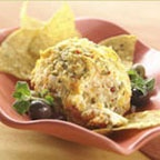 Jack Bola de Queso - A delicious cheese ball made with Mexican seasonings, crushed tortilla chips, pepper Jack, cheddar cheese and cream cheese. Serve with tortilla chips or crackers.