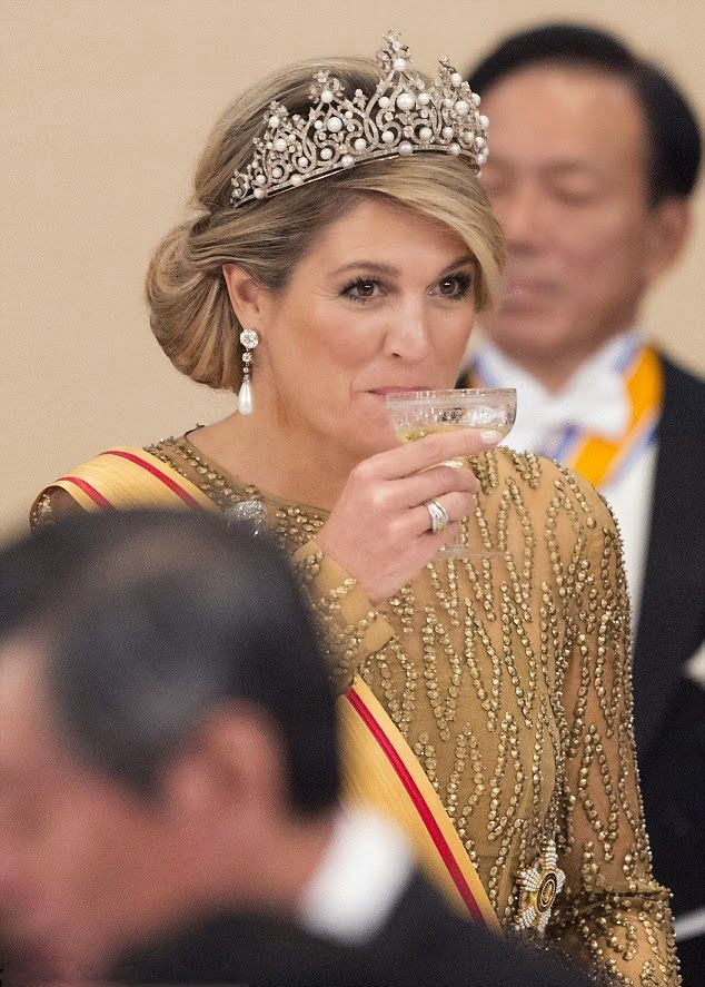 Queen Maxima sipped on her drink as she enjoyed the state banquet
