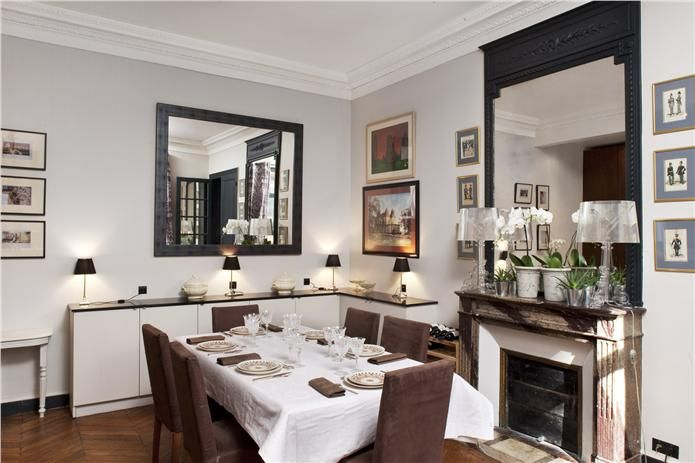 An inspirational image from Farrow and Ball A dining room with walls in Skimming Stone Estate Emulsion, ceilings and top trim in Wimborne White Estate Emulsion and trim / picture frames in Railings Estate Eggshell.