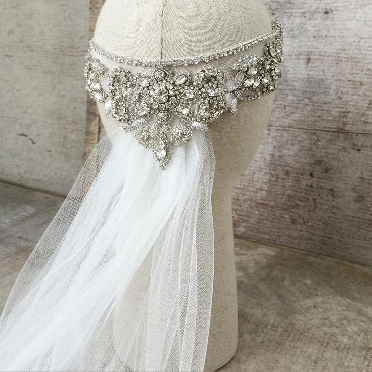 The Blossom headpiece styled with a Single tier veil... Anna Campbell bridal
