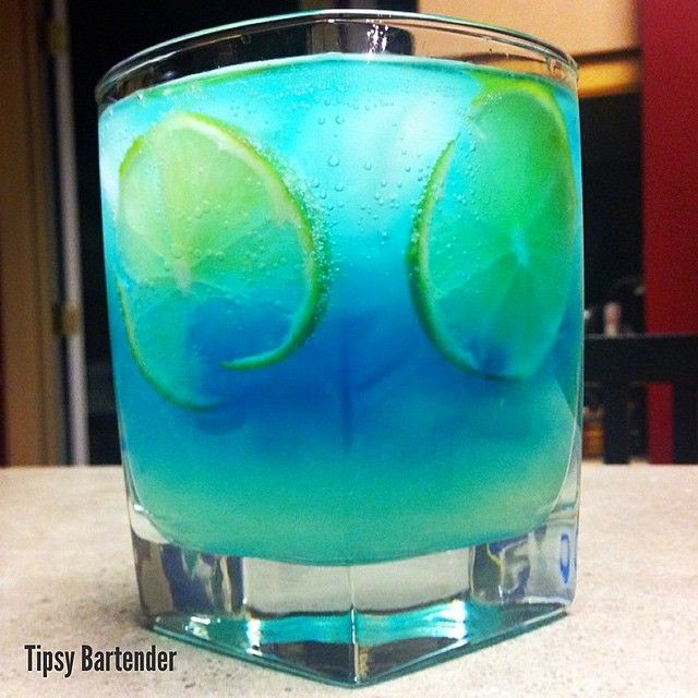 SEXY MONICA 2 parts Grey Goose Citron 1 part Sweet & Sour 1 part Blue Curacao 1 part Lemon Lime Soda 1 part Lime Juice Lime Slices Tipsy Bartender