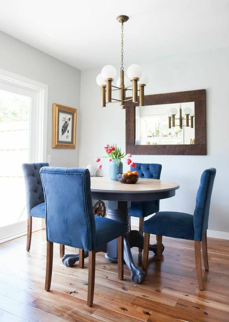 AfterThe blue chairs pop against the wood grain floor  Photo Courtesy of Tessa Neustadt Best 25 Navy dining ideas on Pinterest