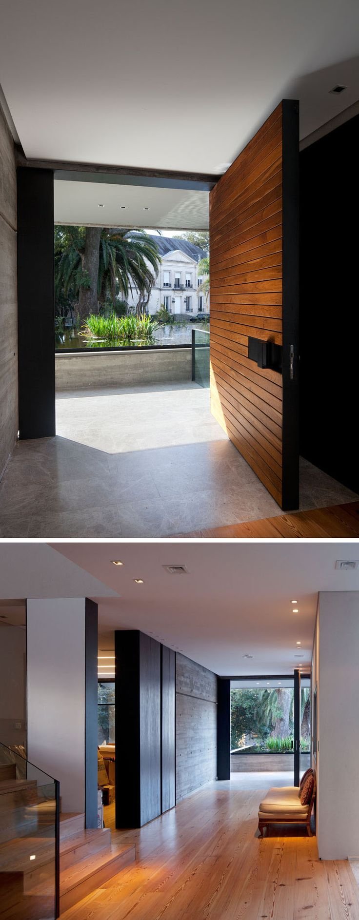 A large pivoting wood front door welcomes you to this modern concrete house, and a foyer provides access to the various levels of the house. #PivotingDoor #WoodFrontDoor #ModernWoodDoor #Foyer