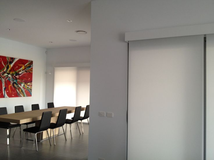 Custom timber pelmets spray painted to match this customers architraves. Luxaflex qmotion roller blinds in a translucent fabric. Picture taken at customers home in Concord Sydney Australia