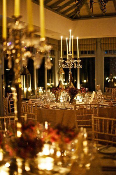 Love the understated beauty of the crystal candelabras and the small groupings of wax flowers underneath