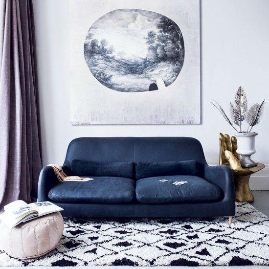 Modern living room with petrol blue sofa