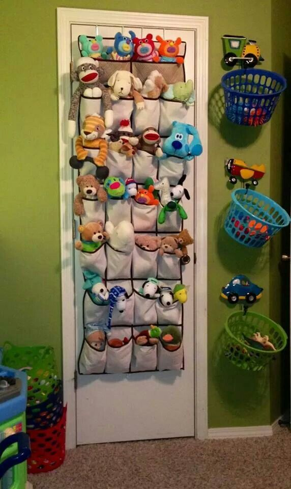 Easy and cheap ways to store toys. Love the dollar store colored baskets on hooks!