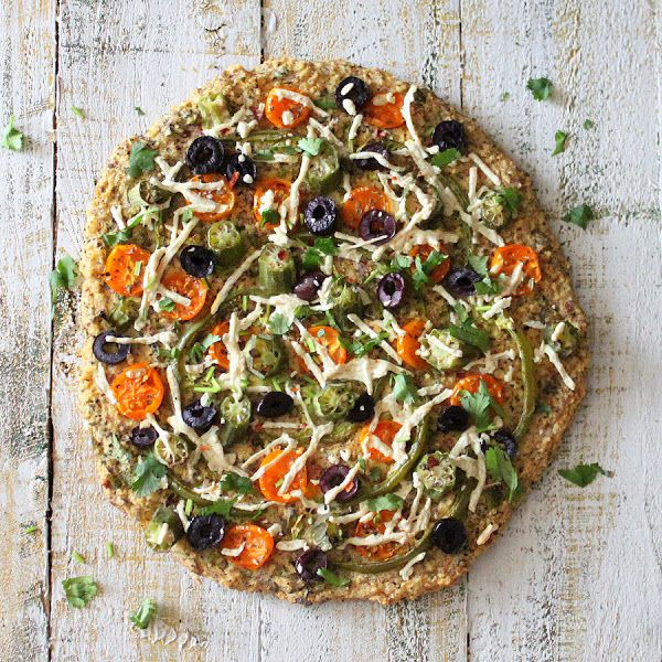 Millet Chickpea Kale Quiche Pizza topped with Okra, golden cherry tomatoes, bell peppers. glutenfree vegan recipe   Vegan Richa