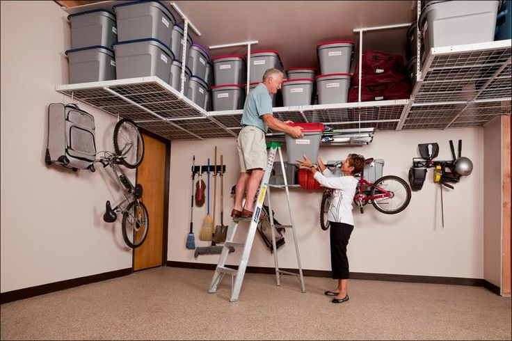 Another example of overhead garage storage which wraps around the garage  opposite the garage doors. (overhead storage solutions - Google Search)