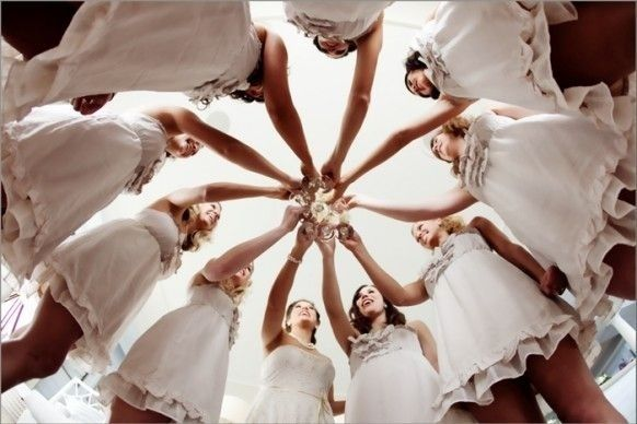 "A ""from below"" shot of the bridesmaids' toast. 