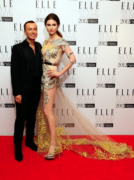 Annie Lennox with designer (whom she is wearing) Julien McDonald at the Elle Fashion Awards 2012