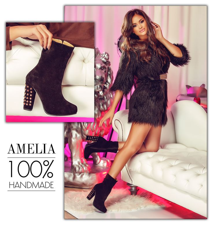 Black leather boots with precious studs on their thick heels @j